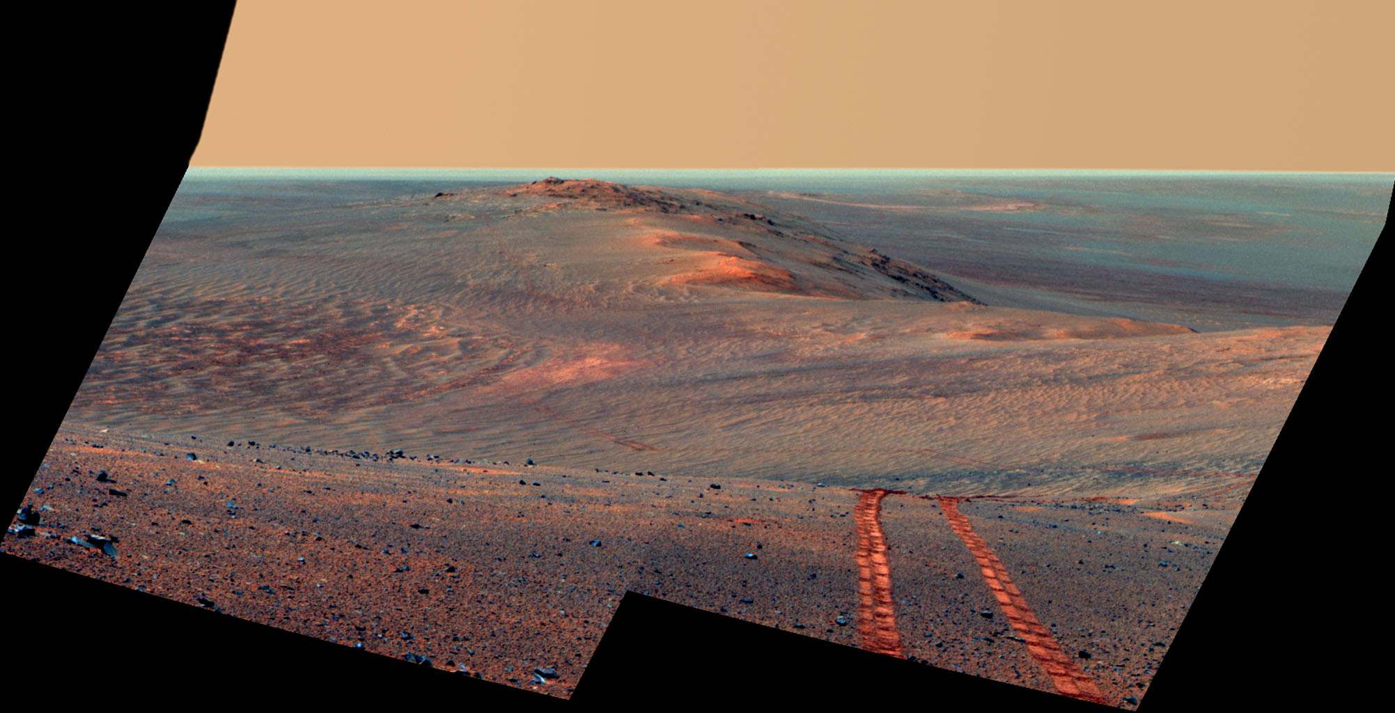 This false-color scene from the Pancam on NASA's Mars Exploration Rover Opportunity looks back toward part of the west rim of Endeavour Crater that the rover drove along, heading southward, during the summer of 2014.