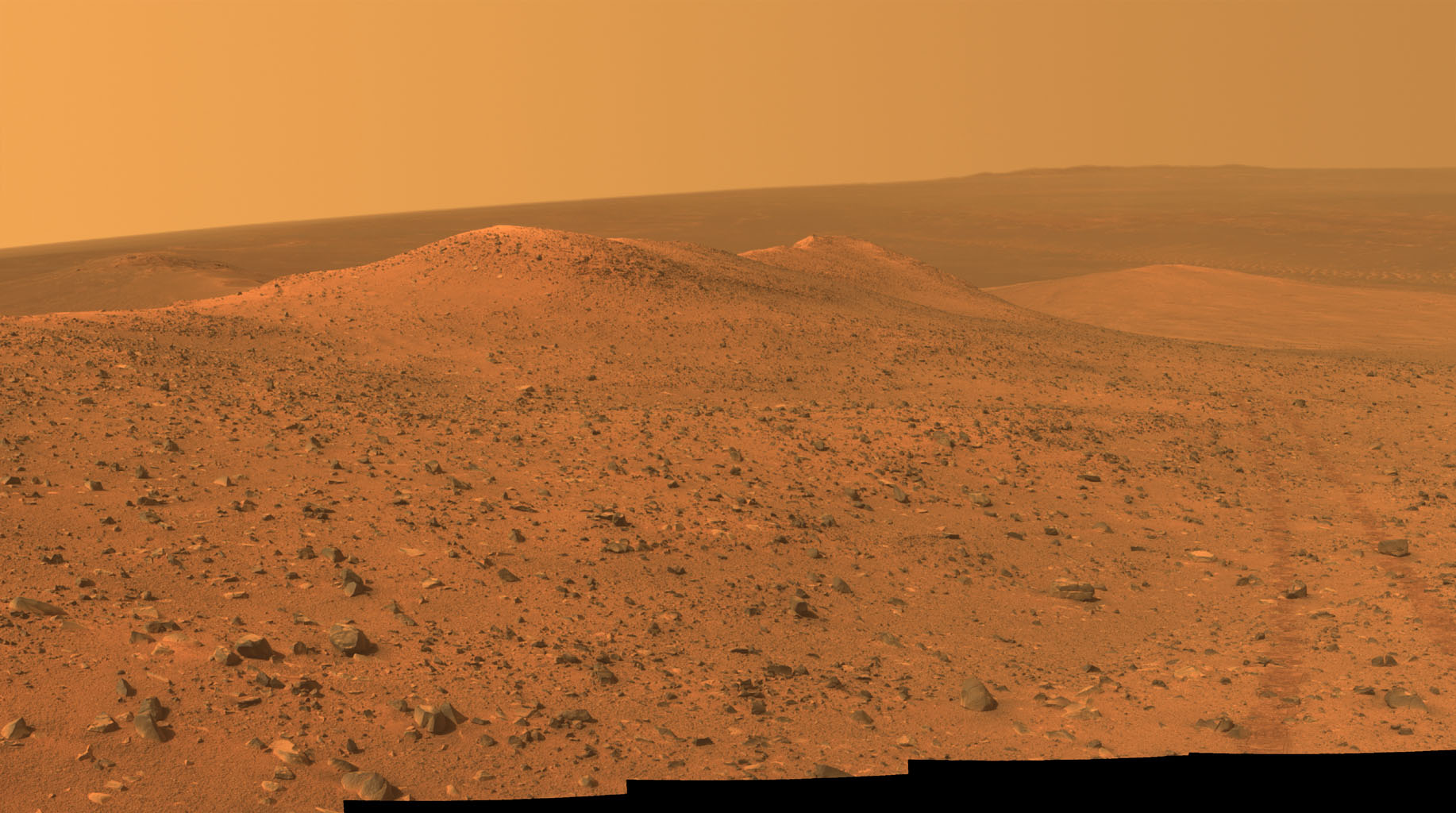 This vista from NASA's Mars Exploration Rover Opportunity shows 'Wdowiak Ridge,' from left foreground to center, as part of a northward look with the rover's tracks visible at right.
