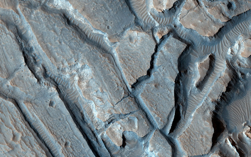 This image from NASA's Mars Reconnaissance Orbiter shows some interesting fractured materials on the floor of an impact crater in Arabia Terra.
