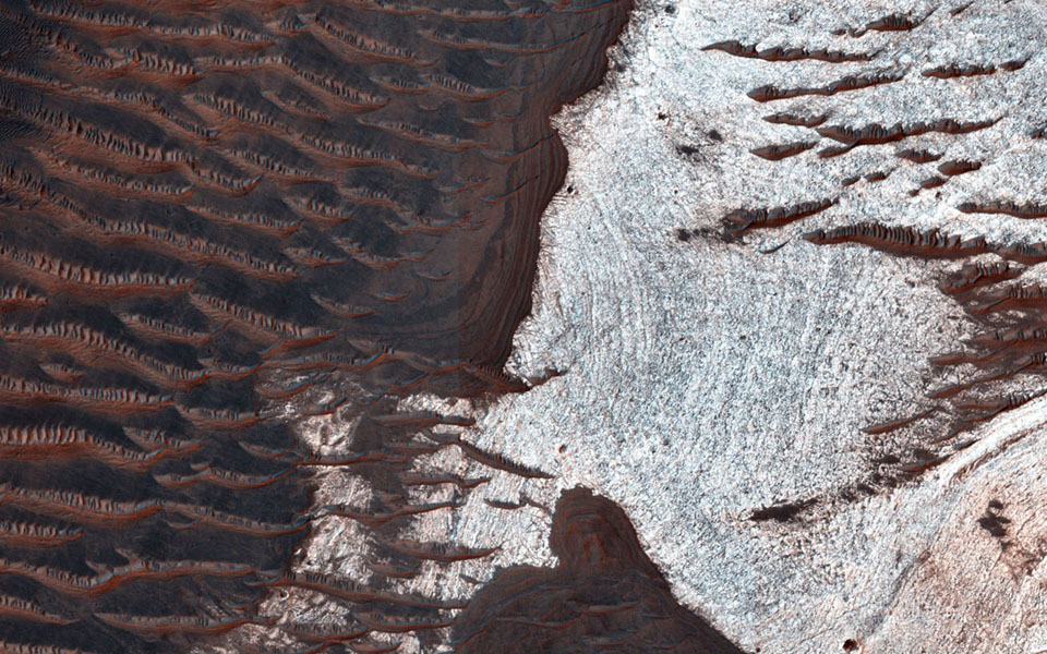 Many of the depressions in Noctis Labyrinthus contain water-bearing minerals, suggesting that water was available and persistent in this region during the Late Hesperian to Amazonian epochs on Mars, as seen by NASA's Mars Reconnaissance Orbiter.
