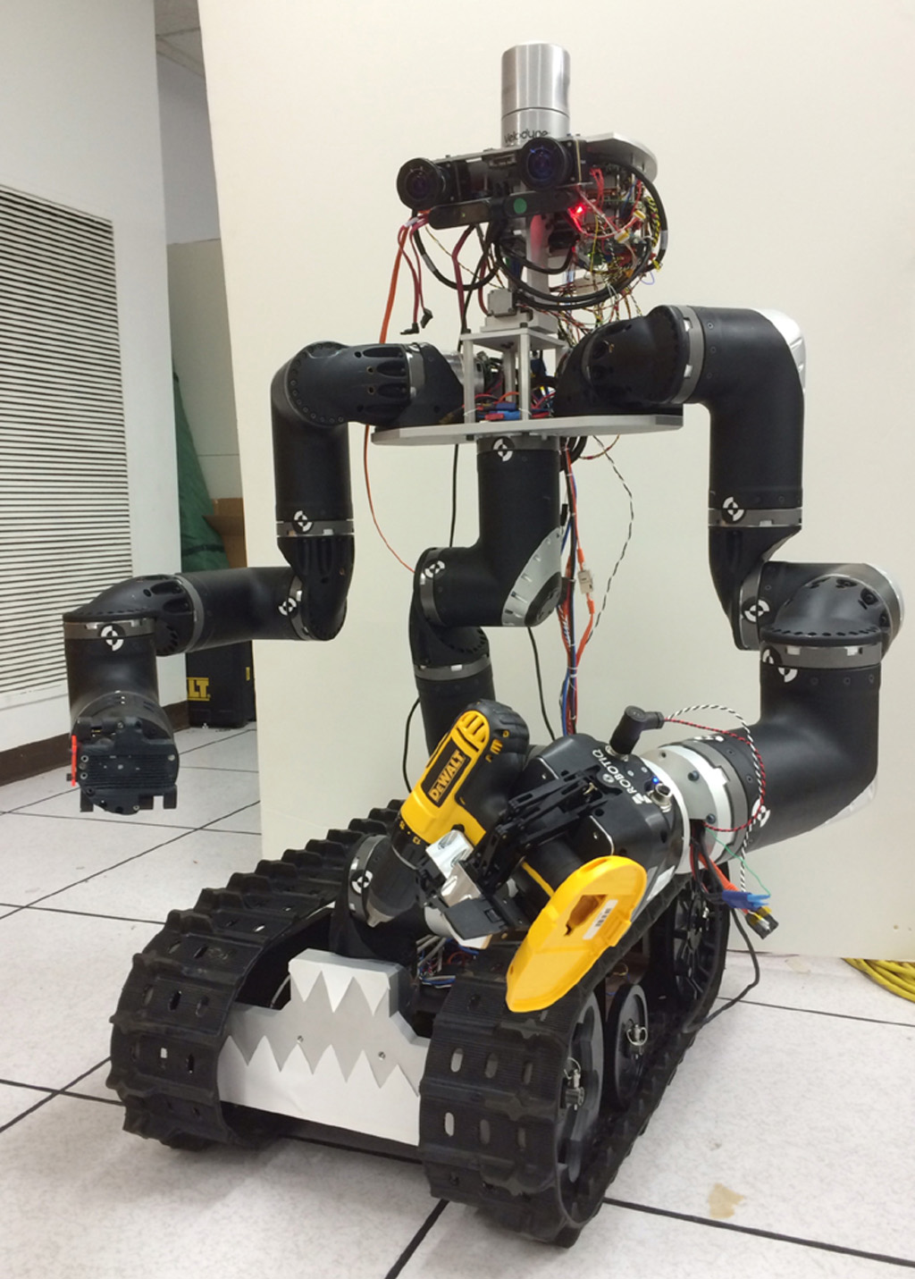 The Surrogate robot ('Surge'), built at NASA's Jet Propulsion Laboratory in Pasadena, CA., is being developed in order to extend humanity's reach into hazardous environments to perform tasks such as using environmental test equipment.