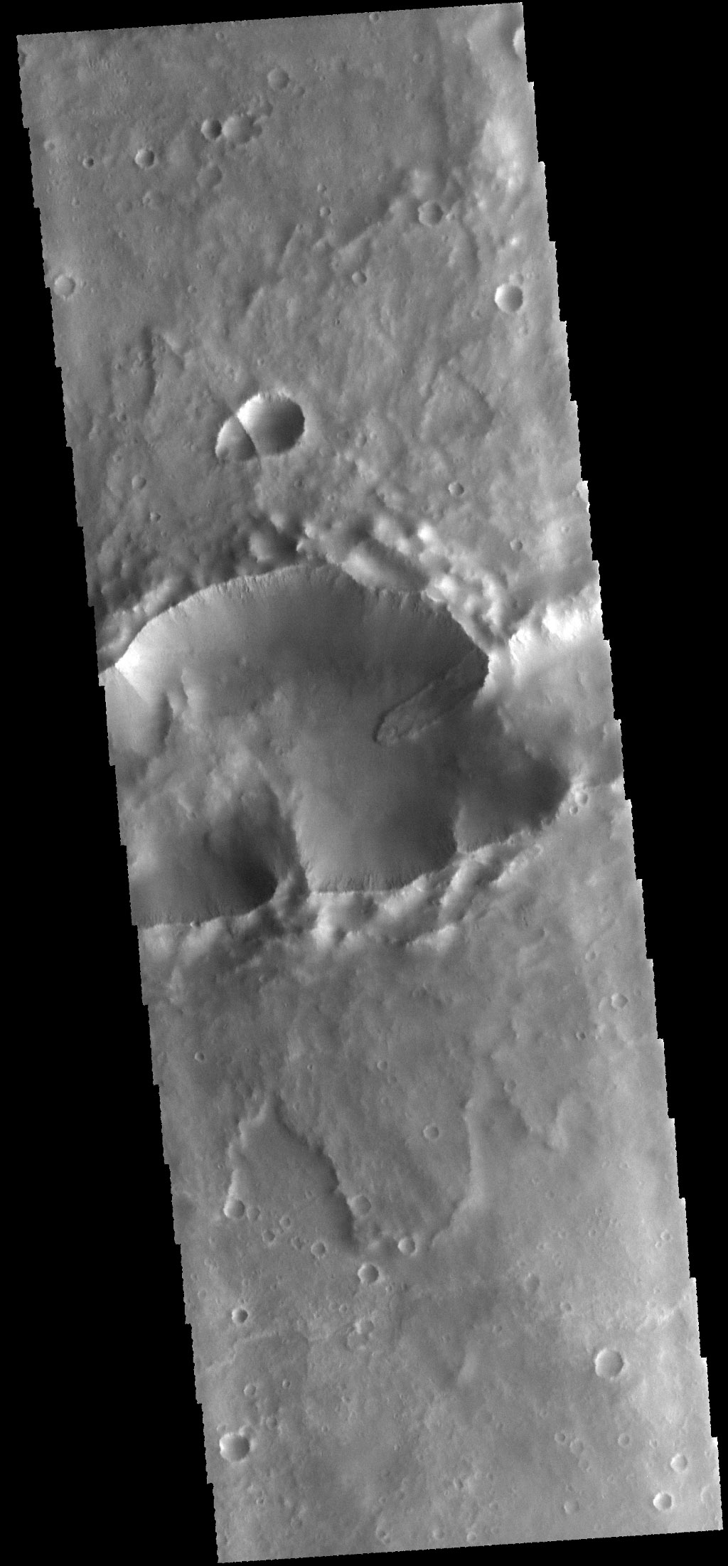 This image from NASA's 2001 Mars Odyssey spacecraft shows a landslide deposit within a complex crater (note the ejecta to the top and bottom of the image). There is a smaller complex crater on the ejecta to the north of the larger crater.