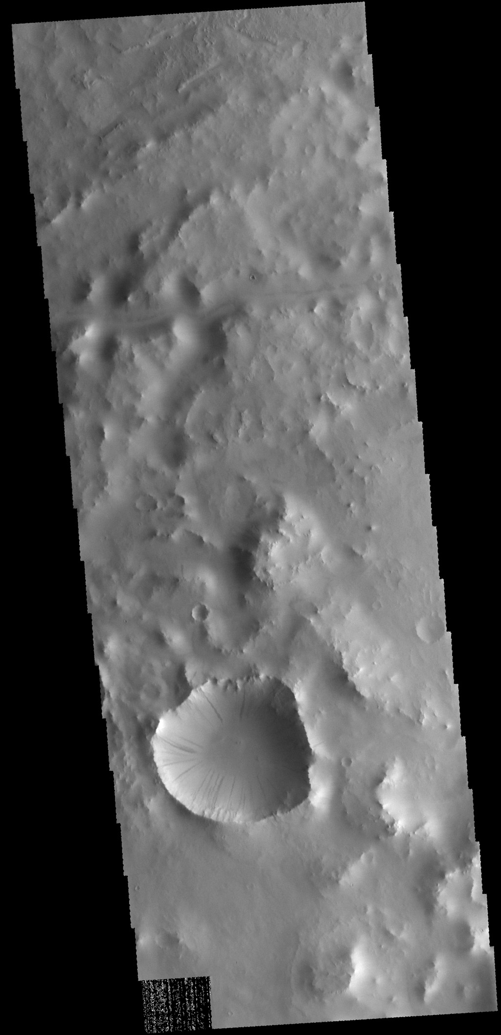 This image from NASA's 2001 Mars Odyssey spacecraft shows dark slope streaks in an unnamed crater in Terra Sabaea. These features are believed to be formed by material moving downslope, removing the dust cover and revealing darker material.