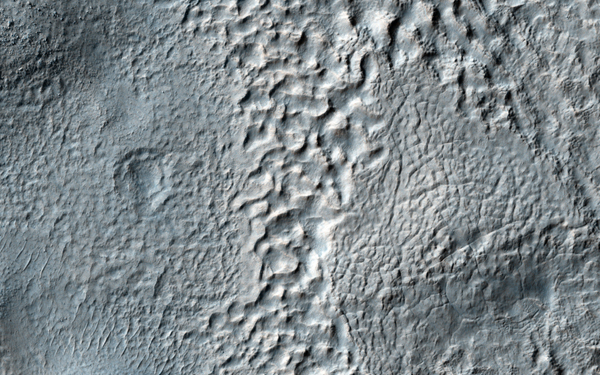 This mantle observed by NASA's Mars Reconnaissance Orbiter is thought to be deposited as snow during periods when the angle of the tilt of Mars' rotational axis-called obliquity-is much higher, which last happened around 10 million years ago.