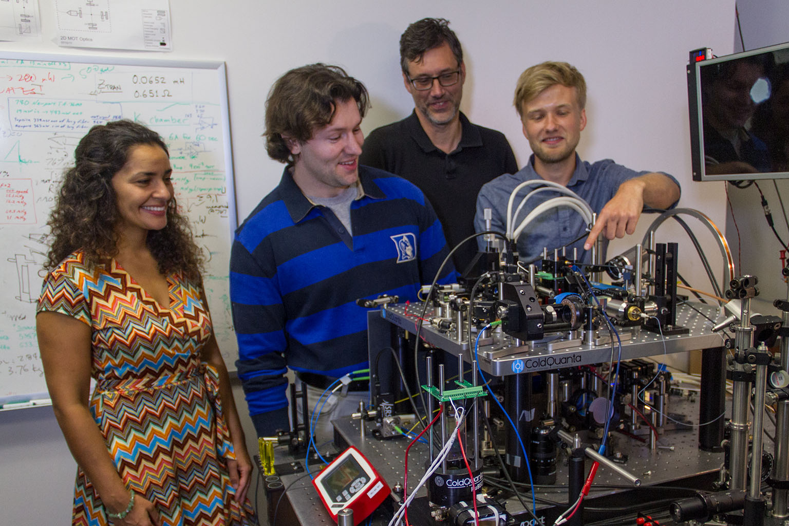 Members of the Cold Atom Laboratory team at NASA's Jet Propulsion Laboratory are seen here with their ground-based testbed, which can reliably create a Bose-Einstein condensate.