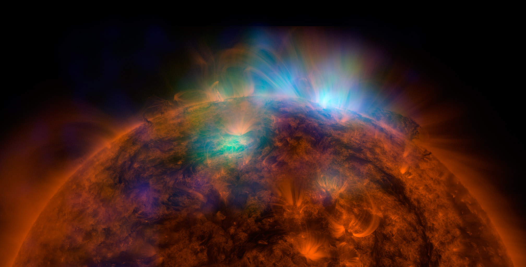 X-rays stream off the sun in this first picture of the sun, overlaid on a picture taken by NASA's Solar Dynamics Observatory, taken by NuSTAR.