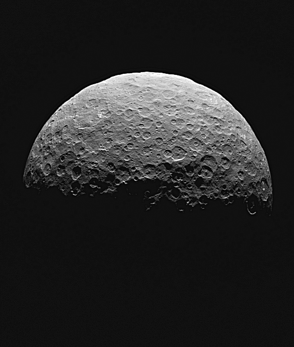 This frame from an animated sequence of images shows northern terrain on the sunlit side of dwarf planet Ceres as seen by NASA's Dawn spacecraft on April 14 and 15, 2015.