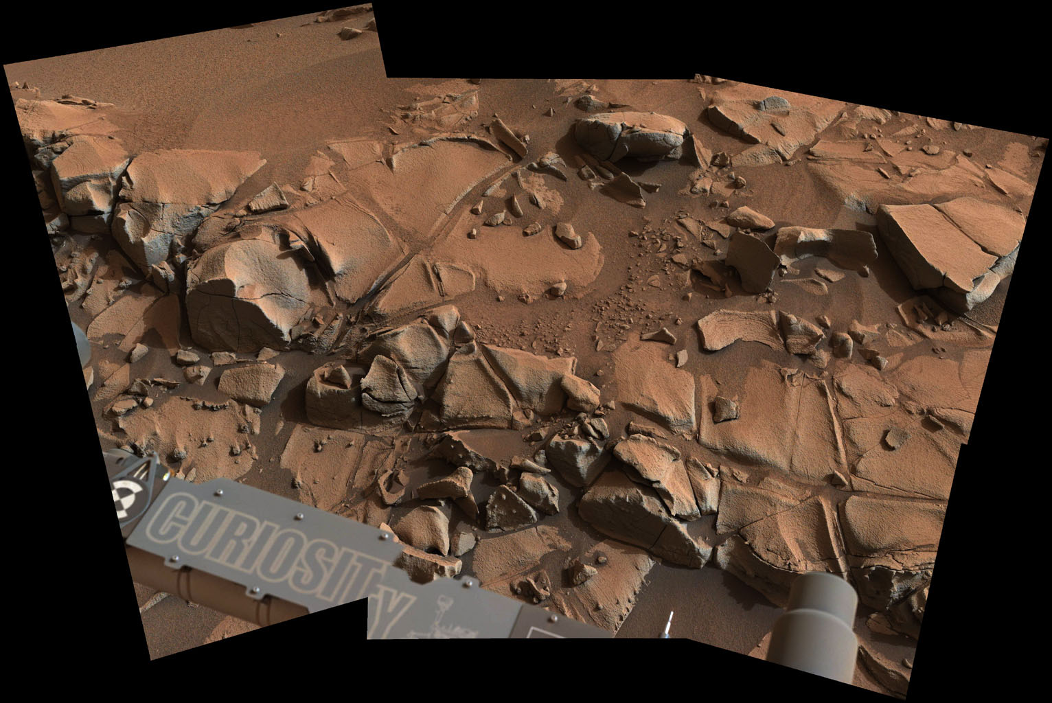 This view from ASA's Curiosity Mars rover shows a swath of bedrock called 'Alexander Hills,' which the rover approached for close-up inspection of selected targets. It is a mosaic of six frames taken on Nov. 23, 2014.