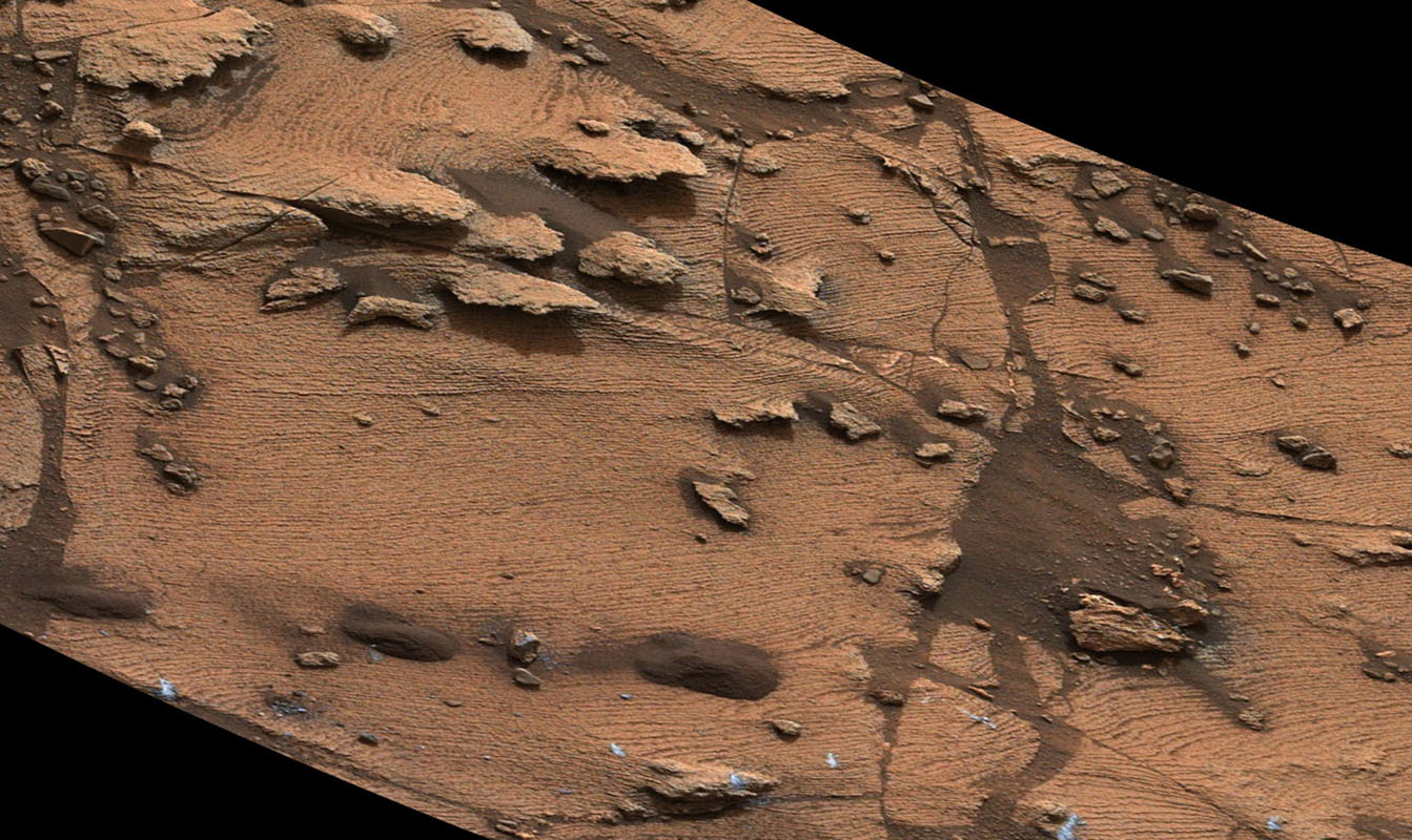 This image from NASA's Curiosity Mars rover shows an example of a thin-laminated, evenly stratified rock type that occurs in the 'Pahrump Hills' outcrop at the base of Mount Sharp on Mars. This type of rock can form under a lake.