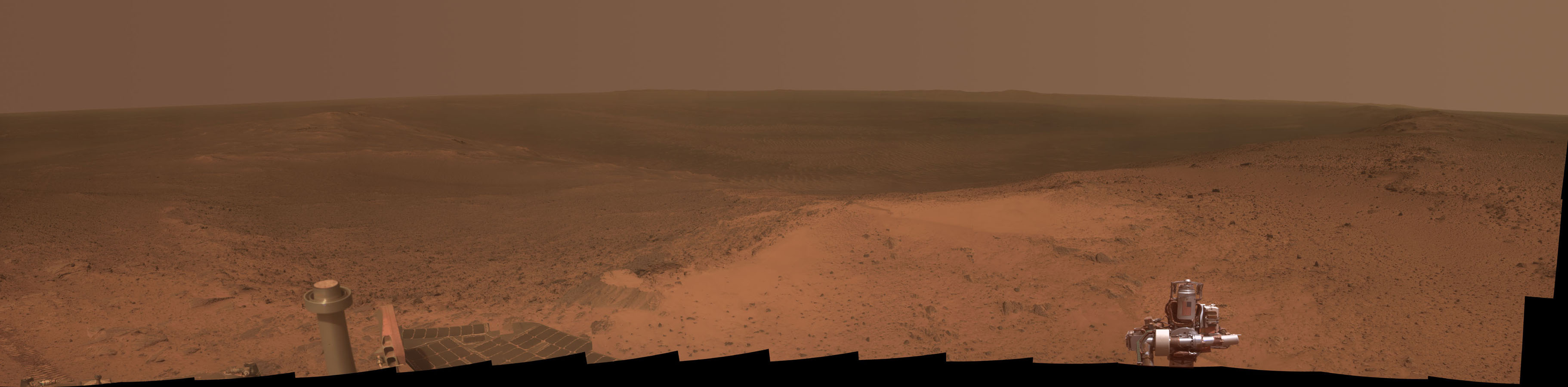 This panorama is the view NASA's Mars Exploration Rover Opportunity gained from the top of the 'Cape Tribulation' segment of the rim of Endeavour Crater.