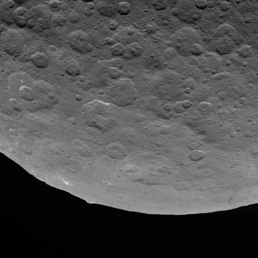 This image, taken on June 18, 2015 by NASA's Dawn spacecraft, shows dwarf planet Ceres from an altitude of 2,700 miles (4,400 kilometers) -- a mountain 3 miles (5 kilometers) high, surrounded by relatively smooth terrain, can be seen here.