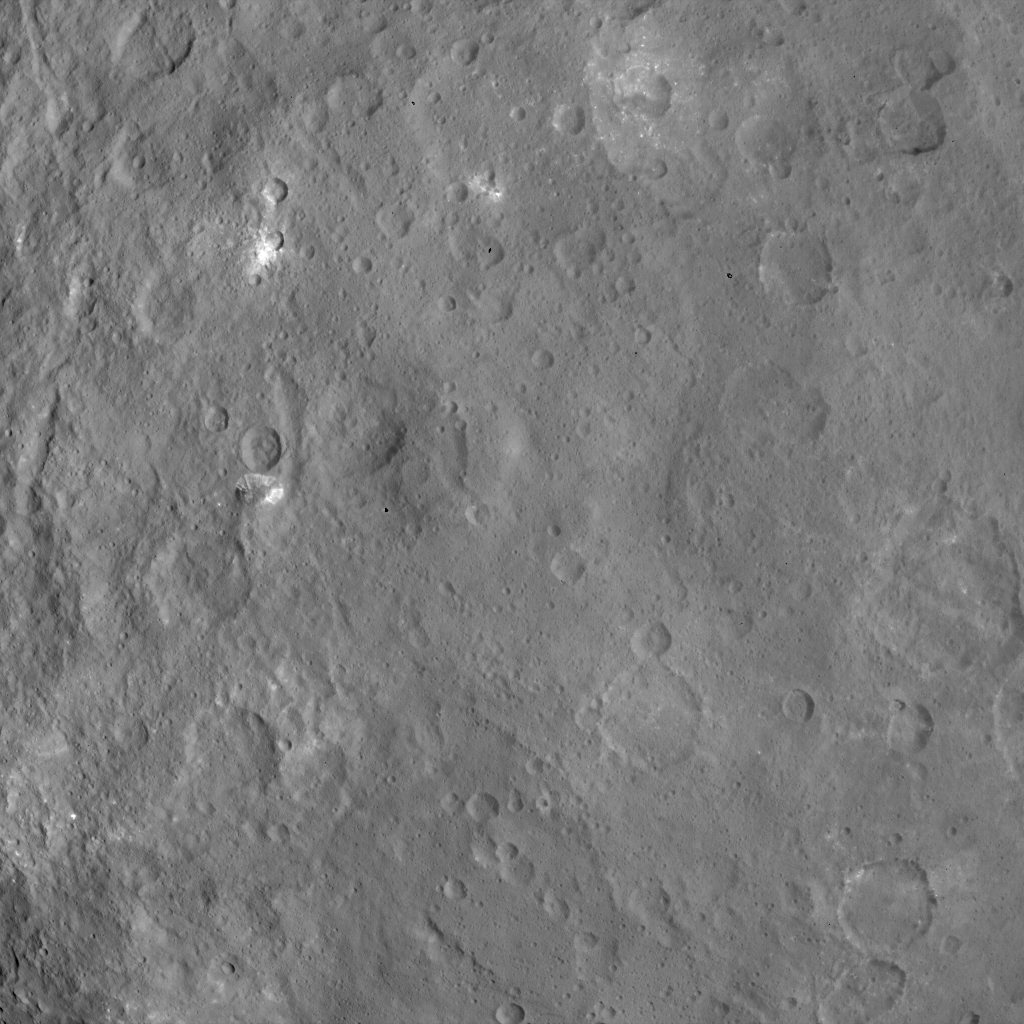 This image, taken on June 6, 2015 by NASA's Dawn spacecraft, shows a mountain on Ceres at center-left that is 4 miles (6 kilometers) high, from an altitude of 2,700 miles (4,400 kilometers) with a resolution of 1,400 feet (410 meters) per pixel.