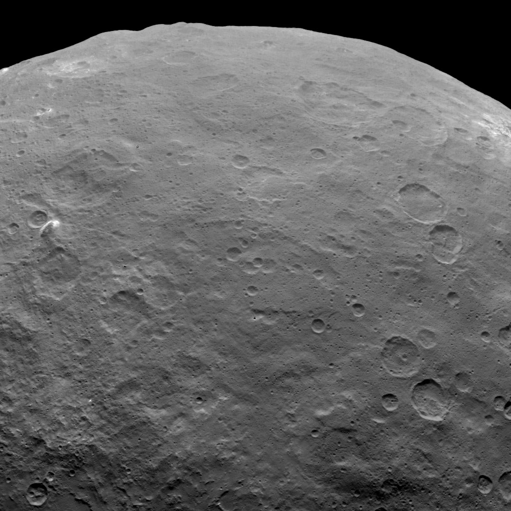 This image, taken on June 6, 2015 by NASA's Dawn spacecraft, shows Ceres from an altitude of 2,700 miles (4,400 kilometers). A mountain can be seen on the left. The western edge of Haulani crater can be seen on the upper right at the limb.