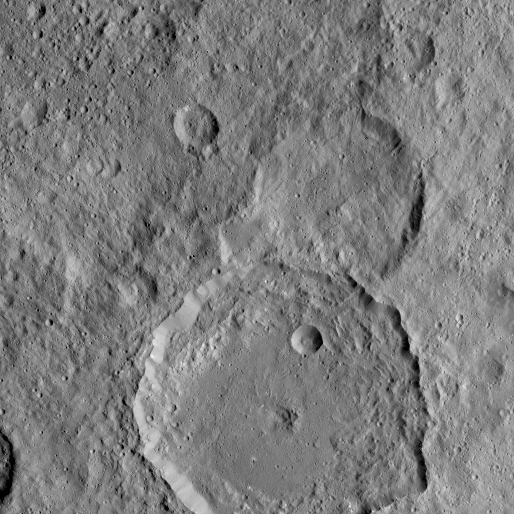 NASA's Dawn Spacecraft took this image of Gaue crater, the large crater on the bottom, on Ceres. Gaue is a Germanic goddess to whom offerings are made in harvesting rye. The resolution of the image is 450 feet (140 meters) per pixel.