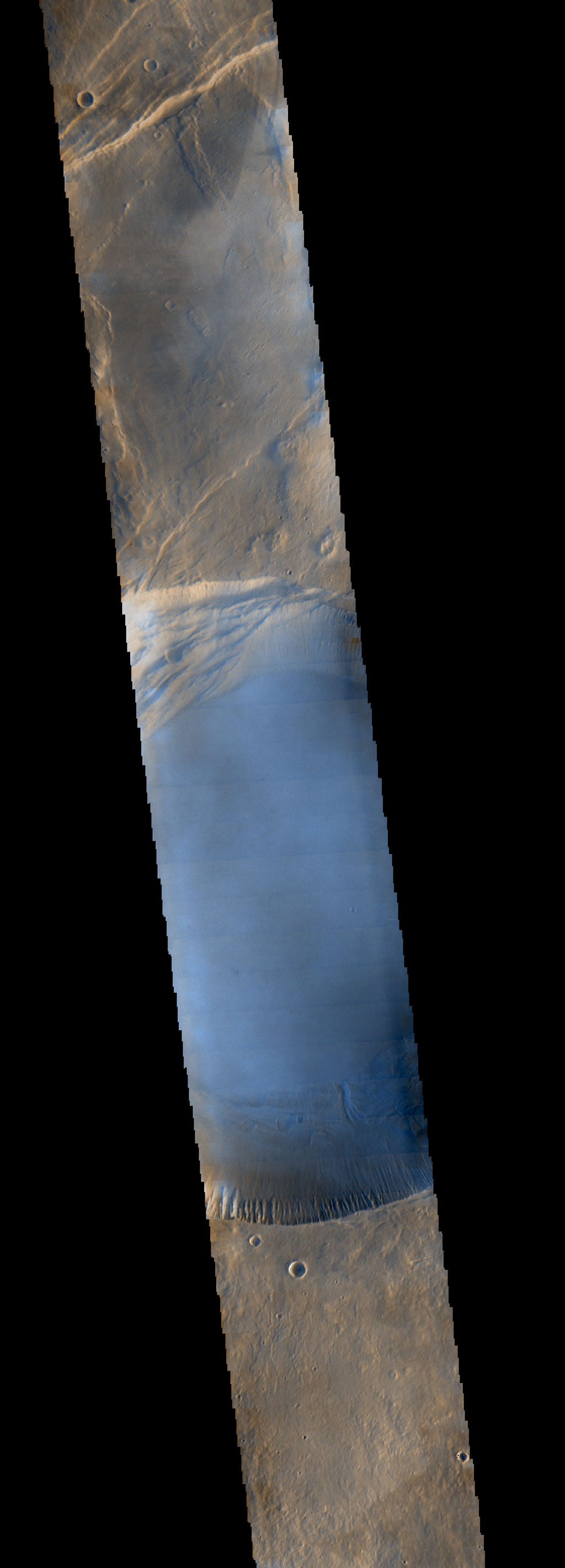 Seen shortly after local Martian sunrise, clouds gather in the summit pit, or caldera, of Pavonis Mons, a giant volcano on Mars, in this image from the Thermal Emission Imaging System (THEMIS) on NASA's Mars Odyssey orbiter.