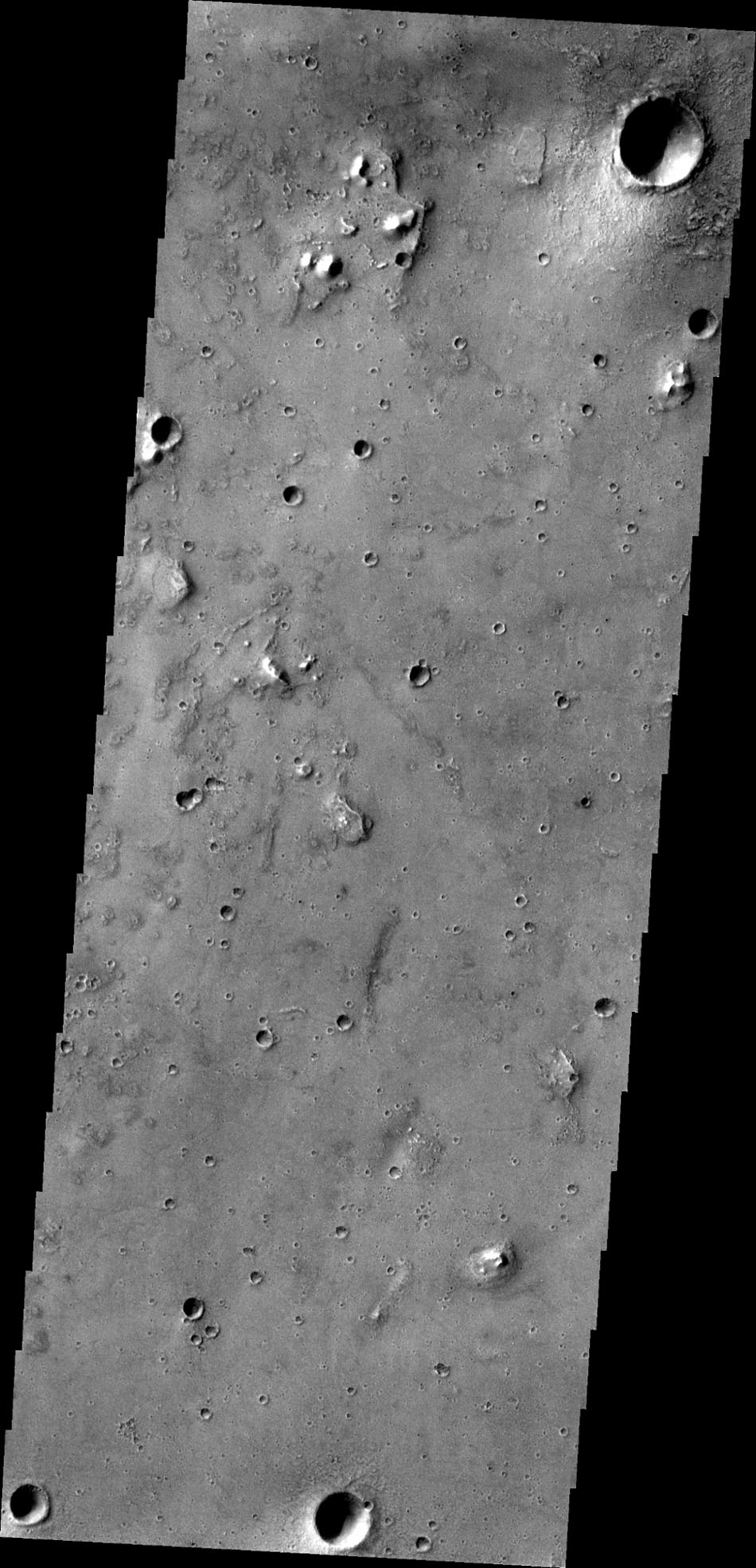 This image captured by NASA's 2001 Mars Odyssey spacecraft shows a small portion of Acidalia Planitia, a largely flat plain that is part of Mars' vast northern lowlands.