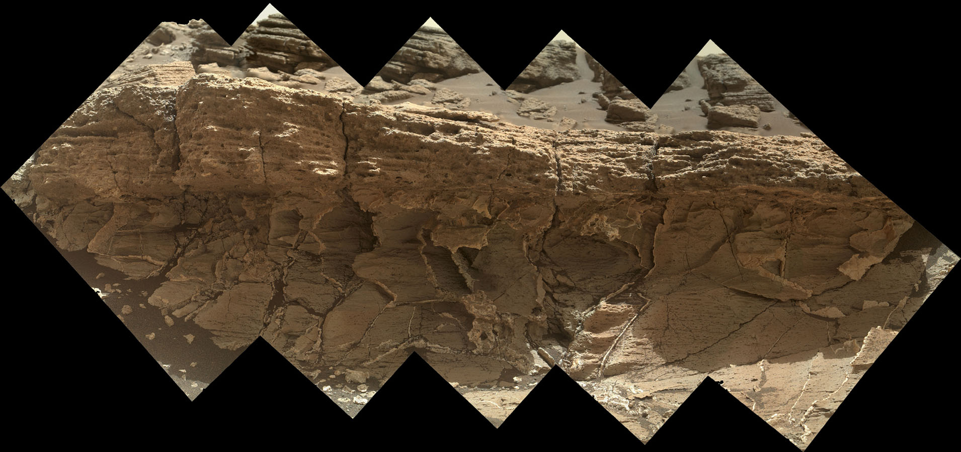 A rock outcrop dubbed 'Missoula,' near Marias Pass on Mars, is seen in this image mosaic taken by NASA's Curiosity rover. Pale mudstone (bottom of outcrop) meets coarser sandstone (top) in this geological contact zone.