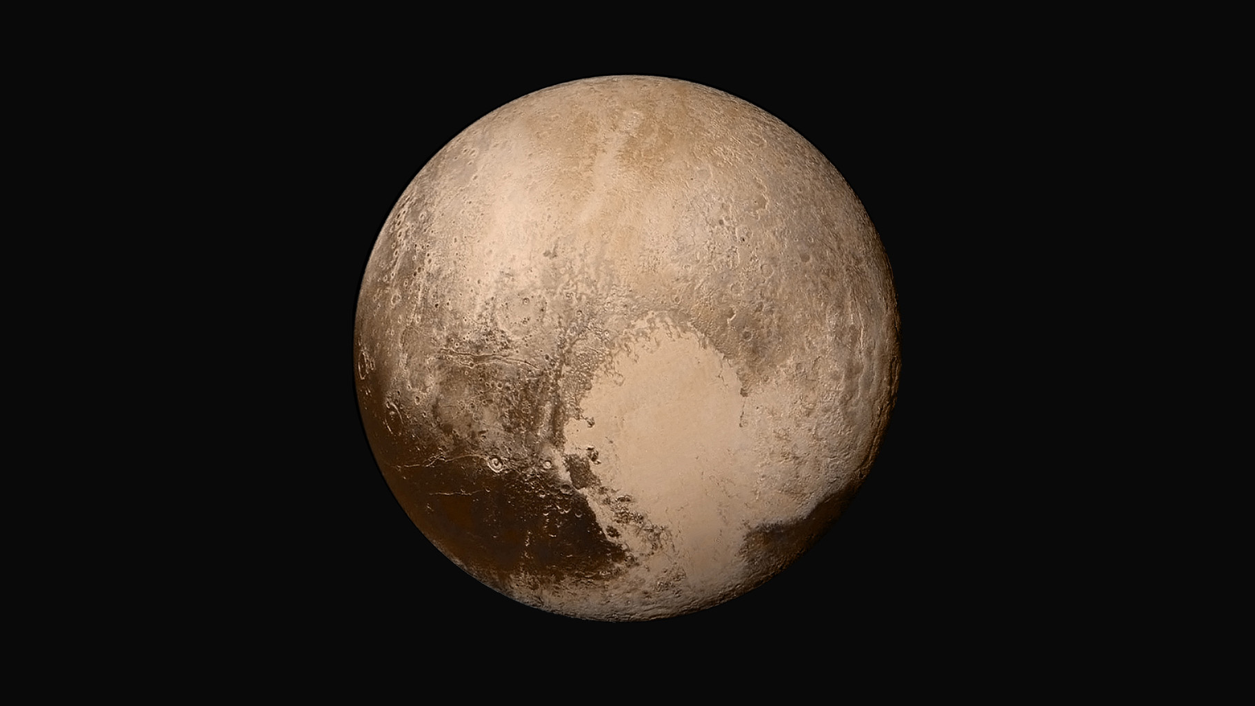 Four images from NASA's New Horizons were combined with color data from the Ralph instrument to create this global view of Pluto. (The lower right edge of Pluto in this view currently lacks high-resolution color coverage.)