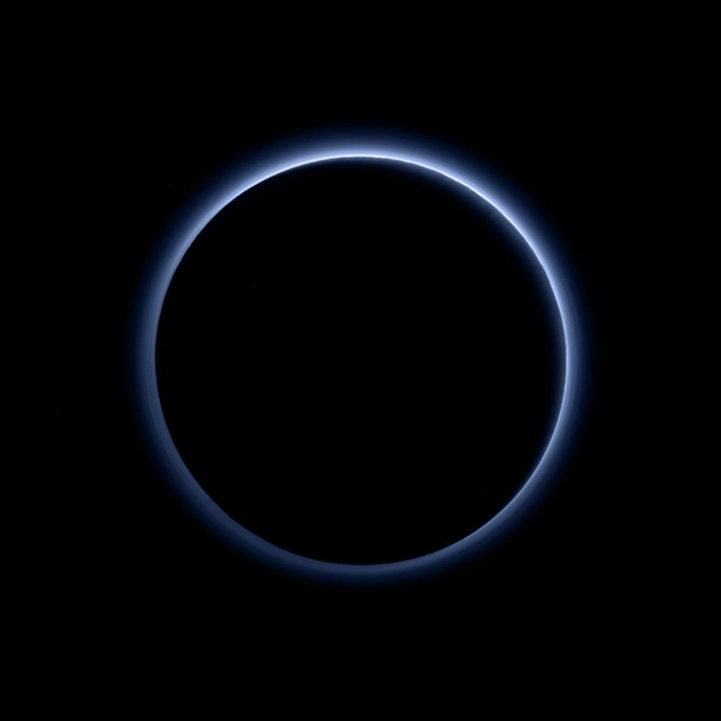 Pluto's haze layer shows its blue color in this picture taken by NASA's New Horizons. The high-altitude haze is thought to be similar in nature to that seen at Saturn's moon Titan.
