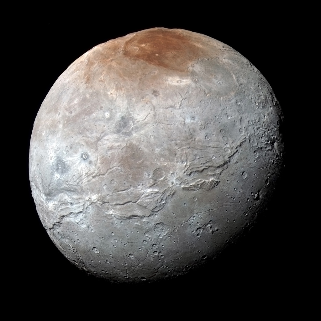 Charon's color palette is not as diverse as Pluto's; most striking is the reddish north (top) polar region, informally named Mordor Macula, as seen by NASA's New Horizons.