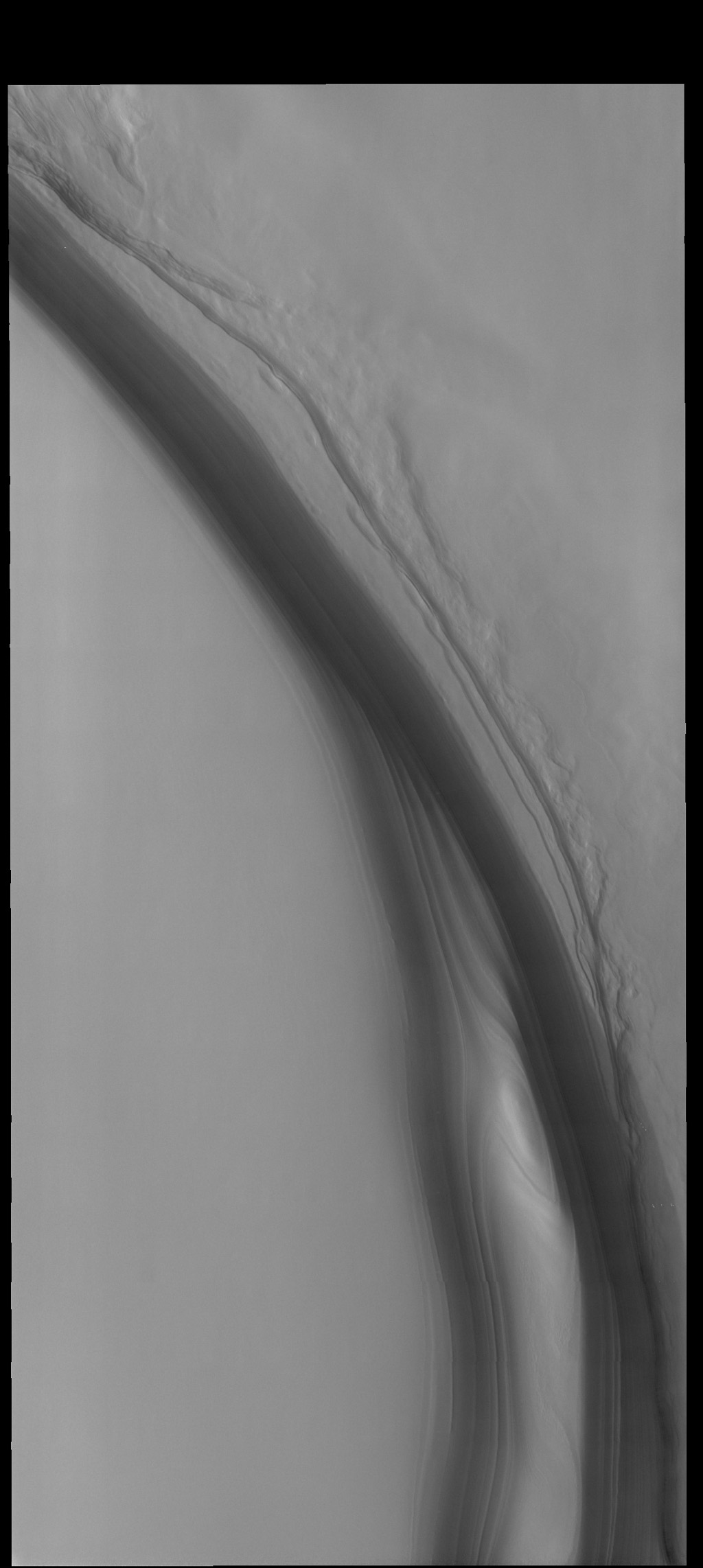 The steep feature in this image from NASA's 2001 Mars Odyssey spacecraft is the margin of the north polar cap, called Olympia Rupes.