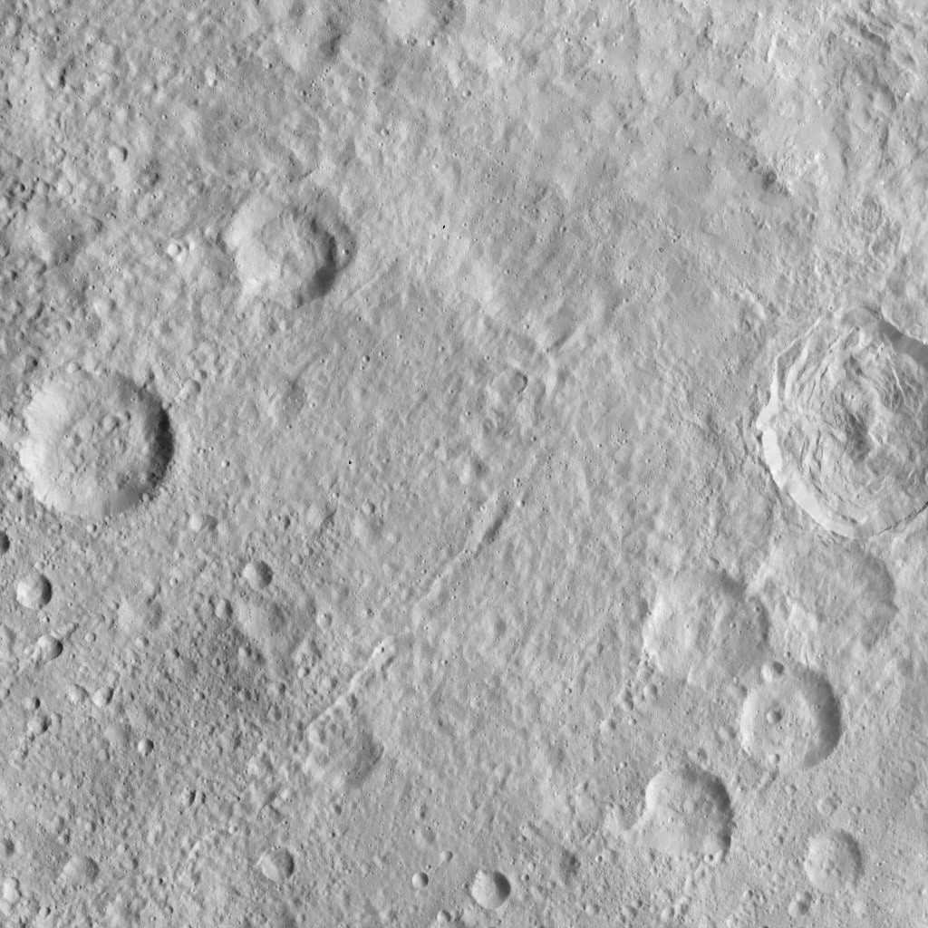 This image, taken by NASA's Dawn spacecraft, displays a linear structure trending from northeast to southwest (lower left to upper right). The graben might be interpreted as a chain of collapsed pits or secondary craters.