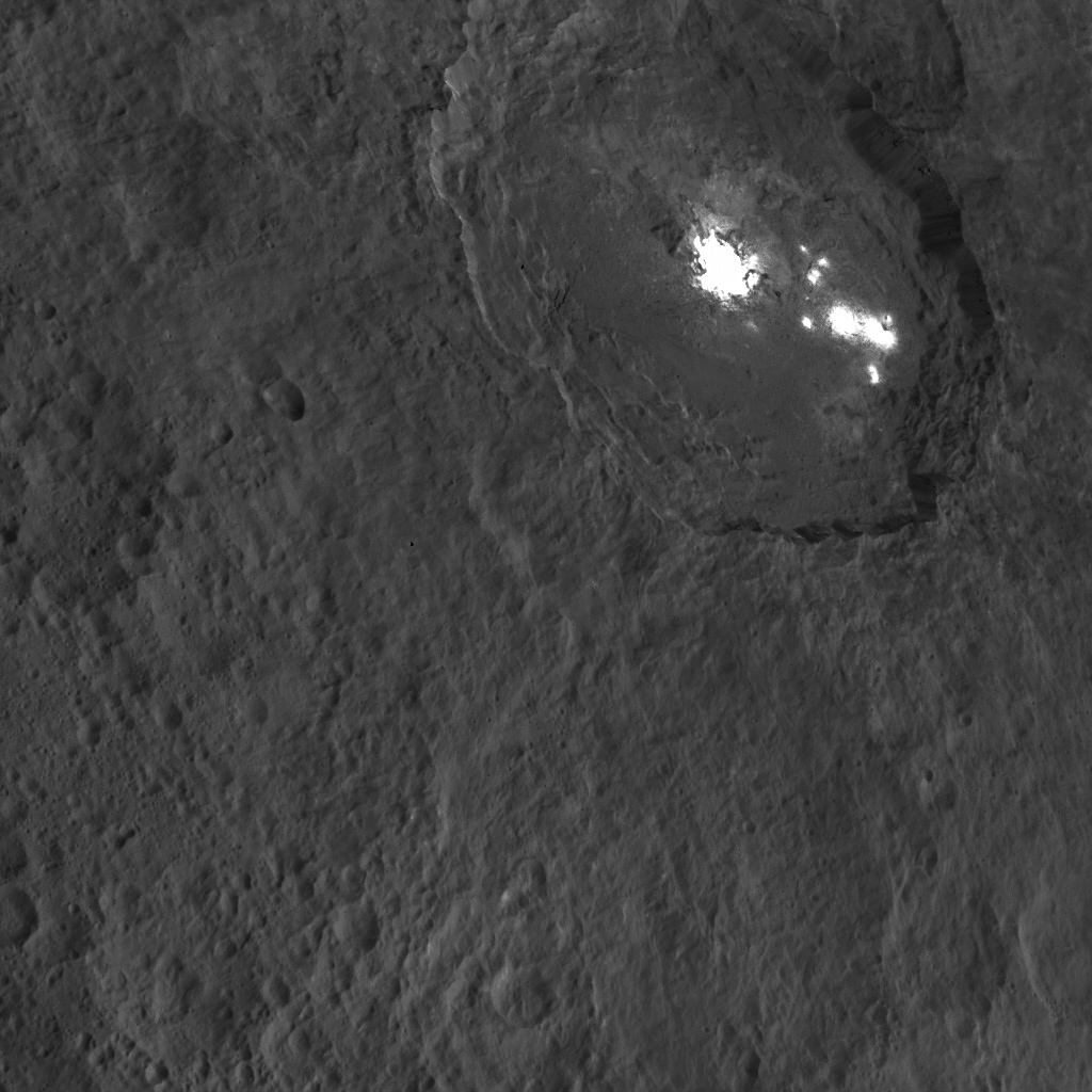 One of the most intriguing features on Ceres, Occator crater, is seen in this oblique view from NASA's Dawn spacecraft and is home to the brightest areas on Ceres. Dawn took this image on Oct. 18, 2015.