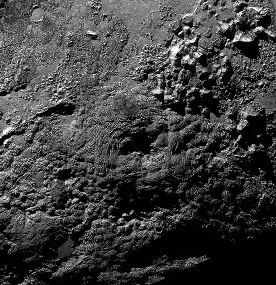 NASA's New Horizons scientists believe that the informally named feature Wright Mons, located south of Sputnik Planum on Pluto, and another, Piccard Mons, could have been formed by the 'cryovolcanic' eruption of ices from beneath Pluto's surface.