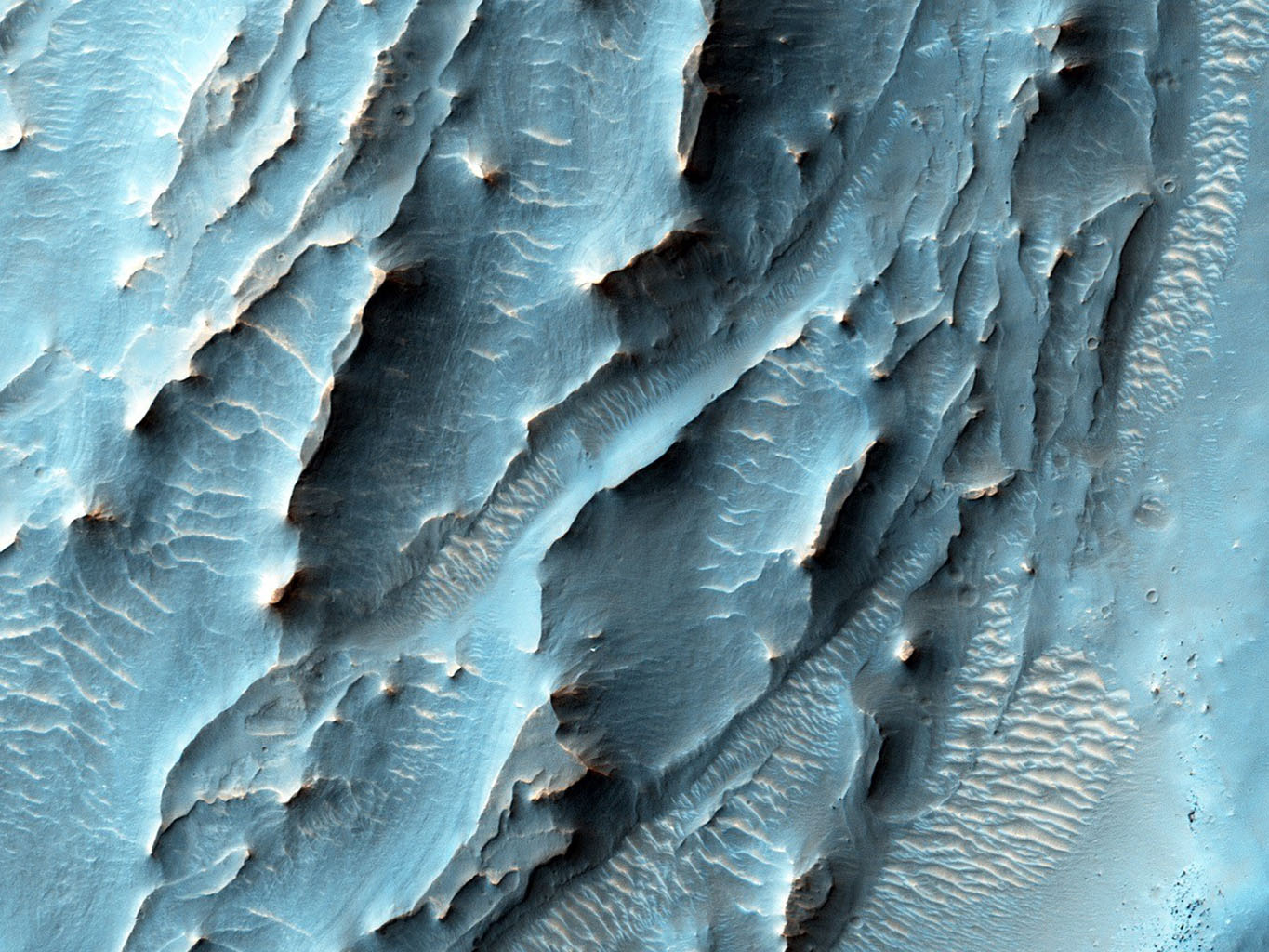NASA's Mars Reconnaissance Orbiter used its HiRISE camera to obtain this view of an area with unusual texture on the southern floor of Gale Crater. An enigmatic deposit appears to have flowed into the small crater from the south.