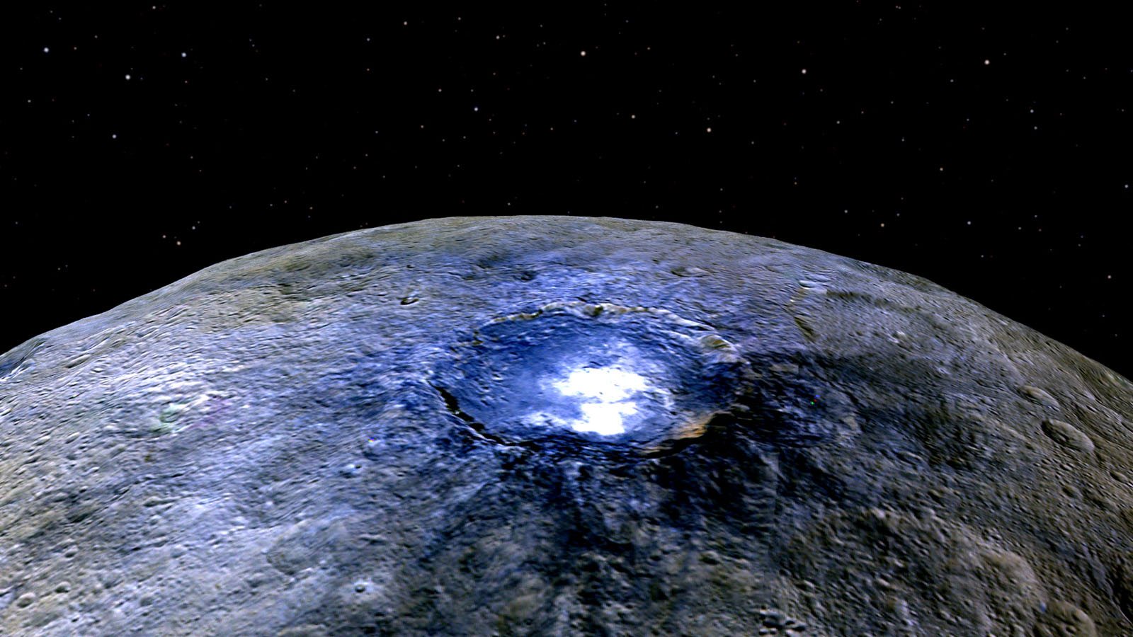 This false color image from NASA's Dawn spacecraft of Ceres' Occator Crater shows differences in surface composition. The color blue is generally associated with bright material seems to be consistent with salts, such as sulfates.