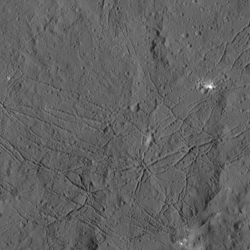 The fractured floor of Dantu Crater on Ceres is seen in this image from NASA's Dawn spacecraft taken on Dec. 21, 2015. Similar fractures are seen in Tycho, one of the youngest large craters on Earth's moon.