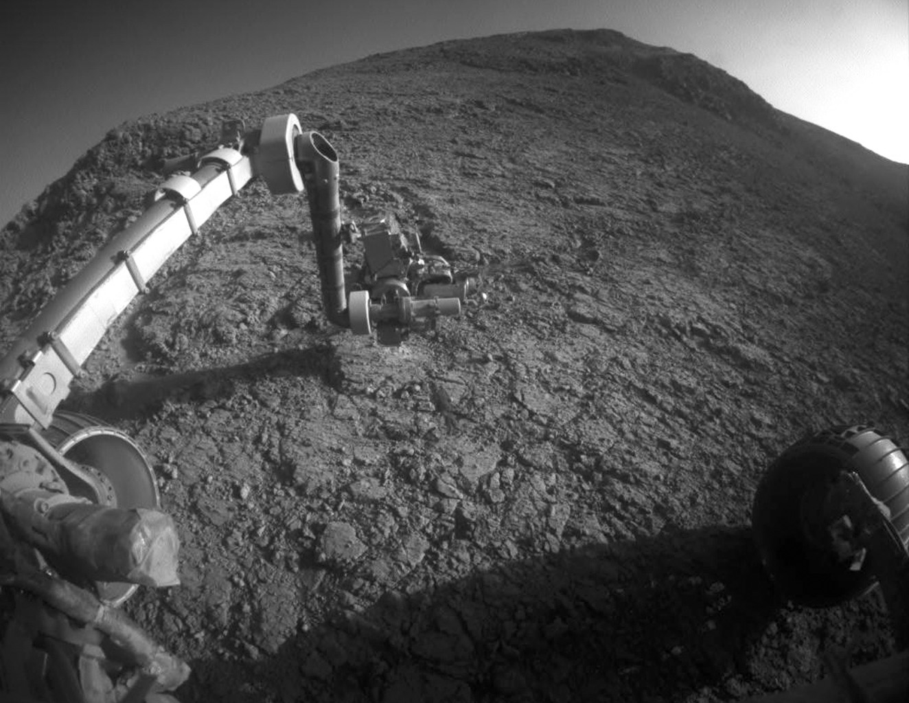 The target beneath the tool turret at the end of the rover's robotic arm in this image from NASA's Mars Exploration Rover Opportunity is 'Private John Potts,' which slices through the western rim of Endeavour Crater.