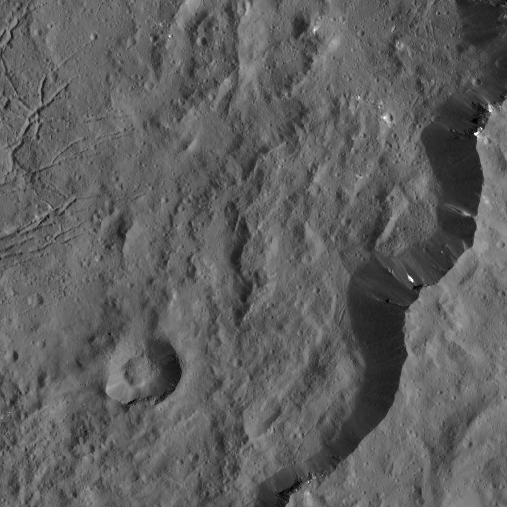 This view from NASA's Dawn spacecraft captures the southeast rim of Dantu Crater. Bright material can be seen in some places along the walls. A network of fractures in the crater floor is visible at upper right.