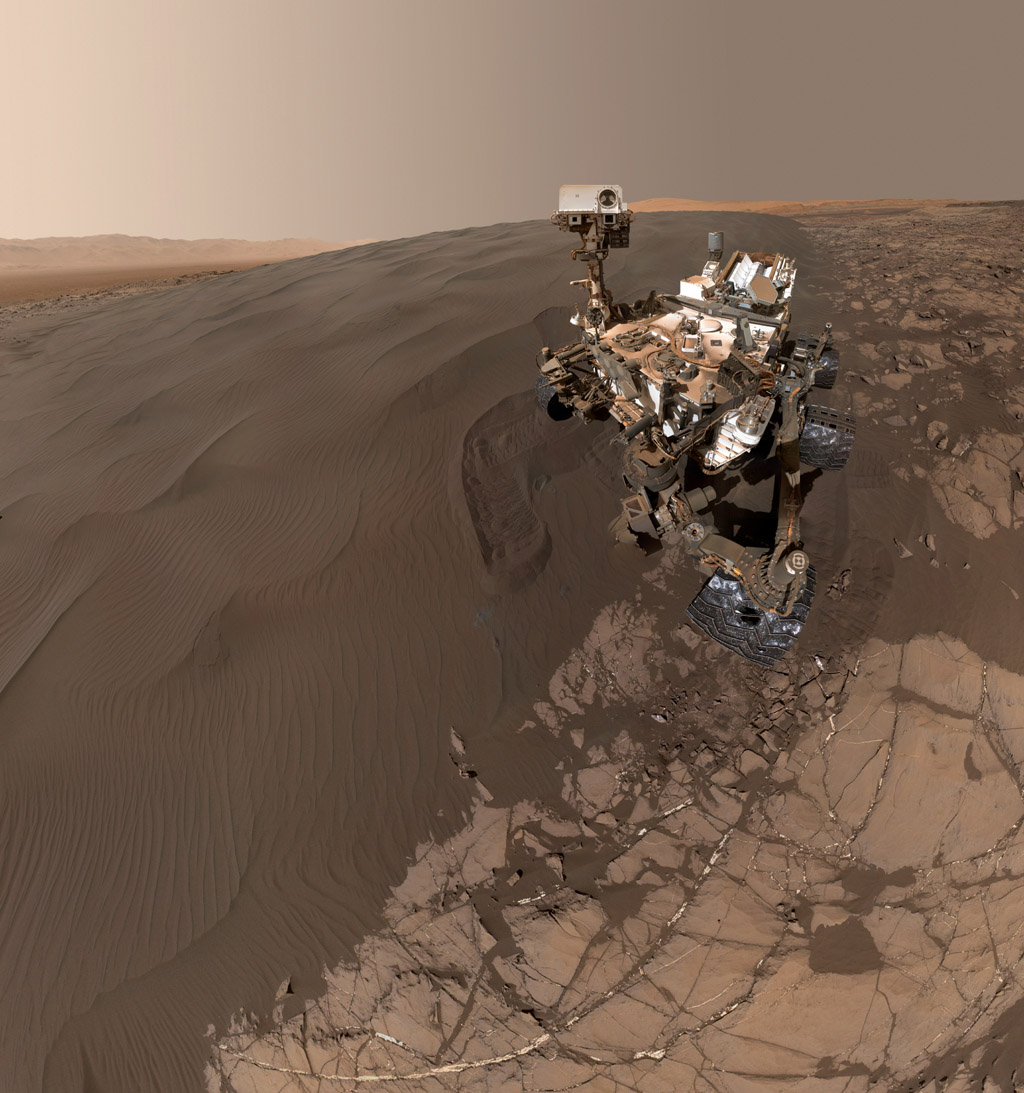 This self-portrait of NASA's Curiosity Mars rover shows the vehicle at 'Namib Dune,' where the rover's activities included scuffing into the dune with a wheel and scooping samples of sand for laboratory analysis.