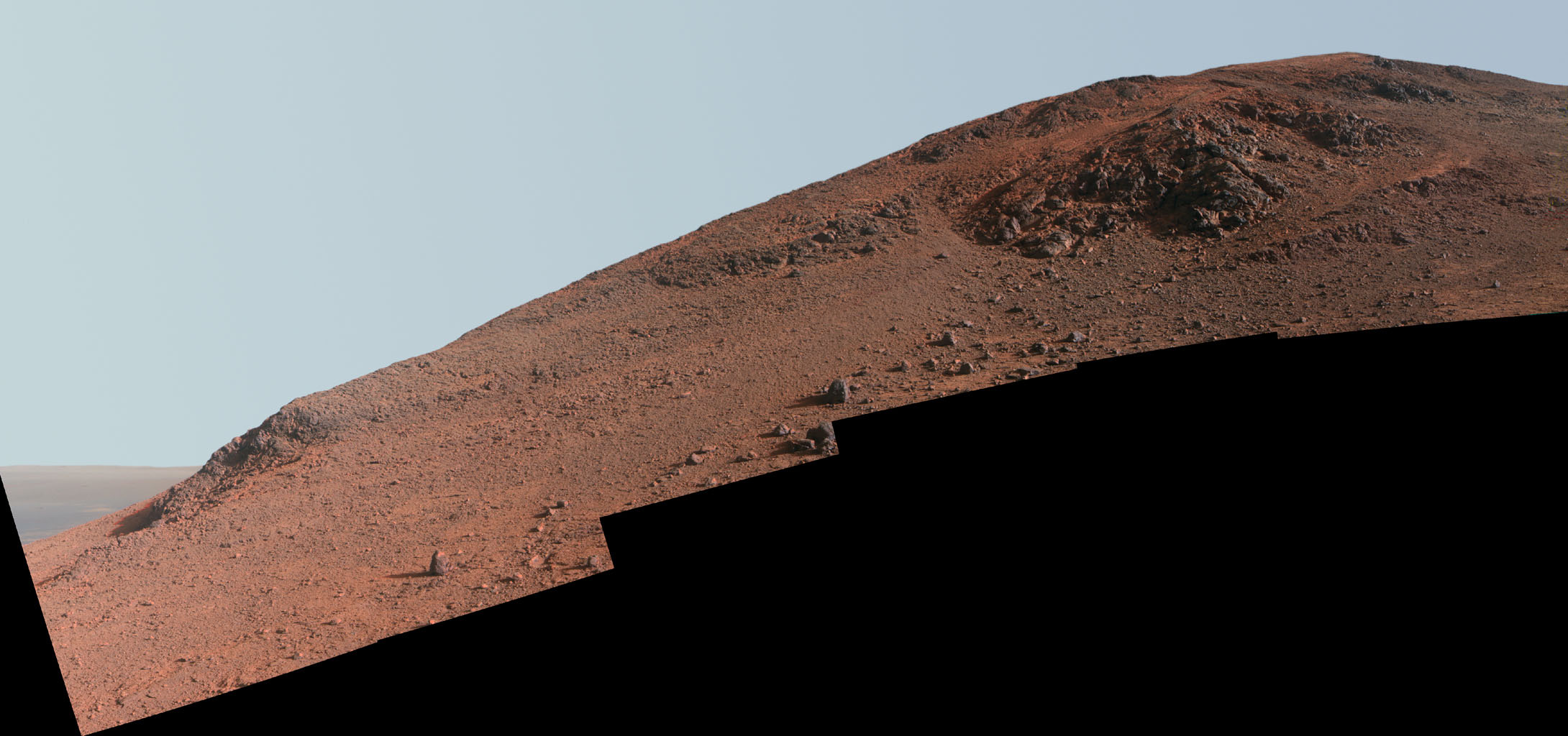 This scene in enhanced color from NASA's Mars Exploration Rover Opportunity looks upward at 'Knudsen Ridge' on the southern edge of 'Marathon Valley' from inside the valley.