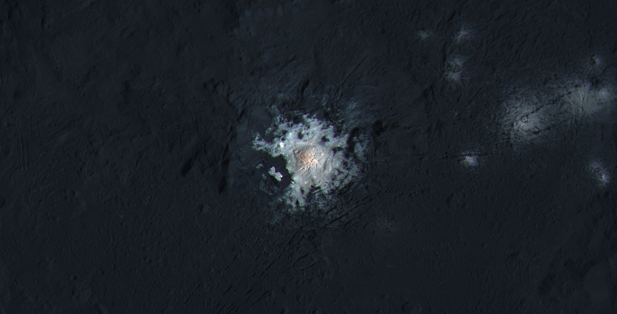 The bright central spots near the center of Occator Crater are shown in enhanced color in this view from NASA's Dawn spacecraft. Such views can be used to highlight subtle color differences on Ceres' surface.