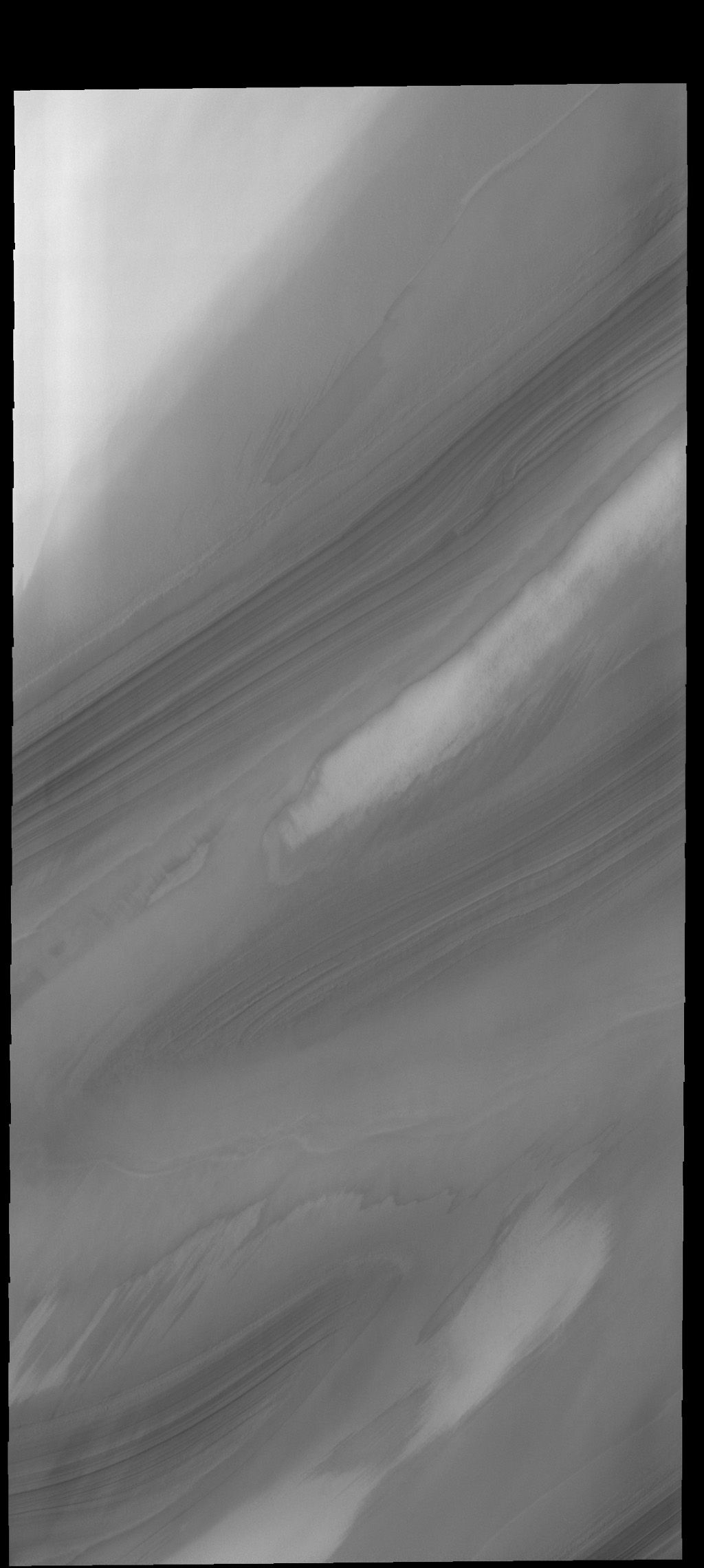 Troughs in the north polar cap reveal the layering of ice and dust, as shown in this image captured by NASA's 2001 Mars Odyssey spacecraft.