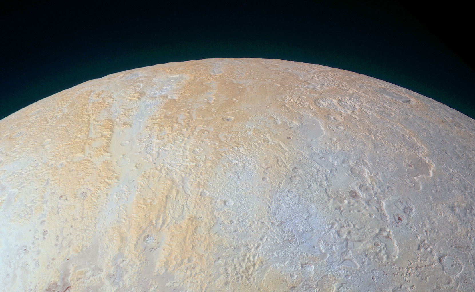 This ethereal scene captured by NASA's New Horizons spacecraft tells yet another story of Pluto's diversity of geological and compositional features-this time in an enhanced color image of the north polar area.