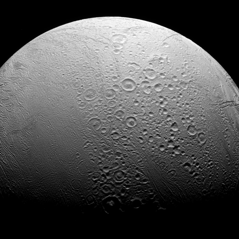 Enceladus is a world divided. To the north, NASA's Cassini spacecraft see copious amounts of craters and evidence of the many impacts the moon has suffered in its history. However, to the south we see a smoother body with wrinkles due to geologic activity