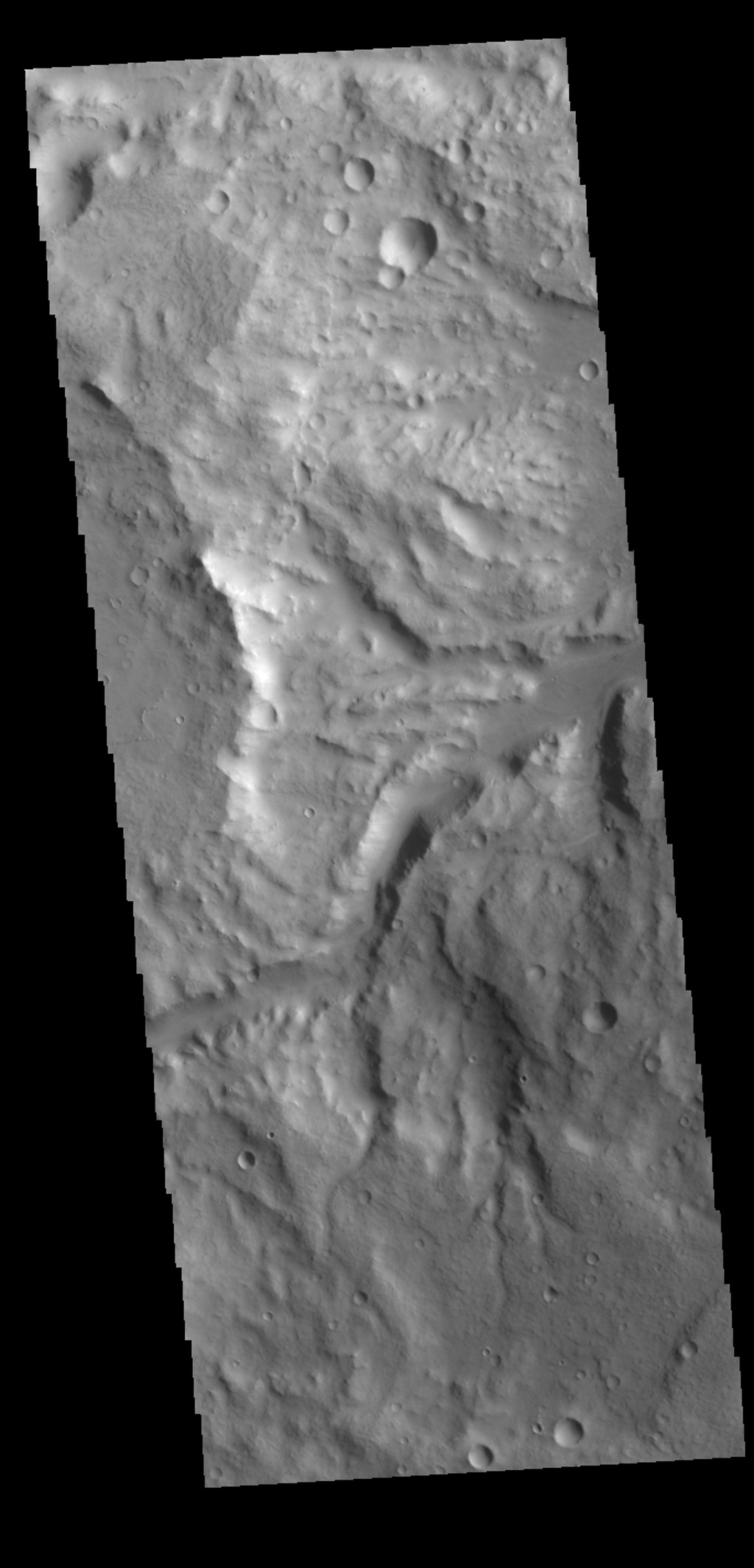 This image captured by NASA's 2001 Mars Odyssey spacecraft shows one of the many unnamed channels in northern Terra Cimmeria.
