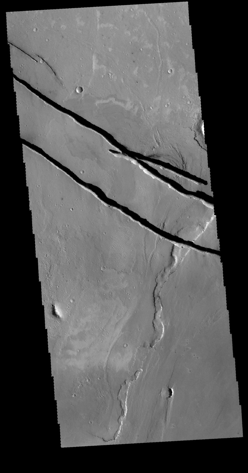 This image captured by NASA's 2001 Mars Odyssey spacecraft shows a portion of Cerberus Fossae.