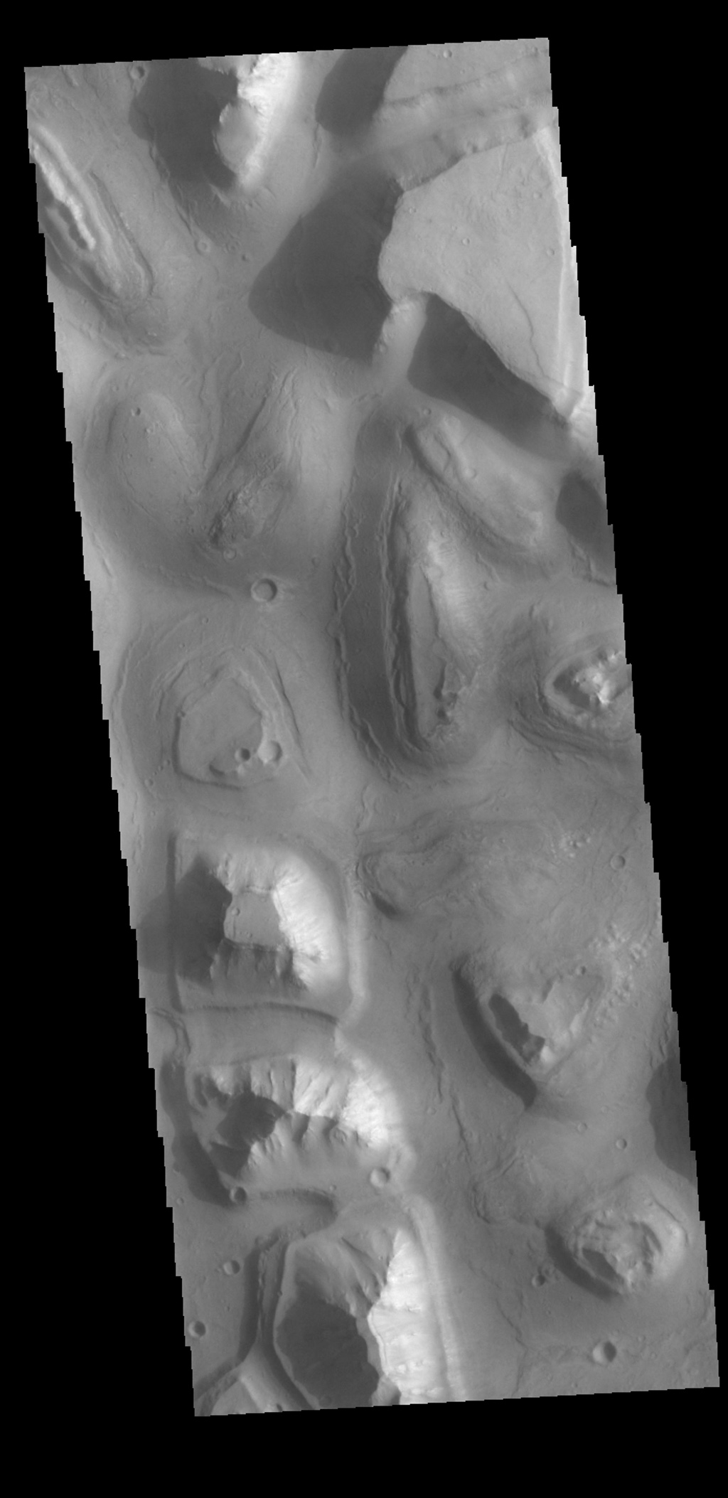 This image captured by NASA's 2001 Mars Odyssey spacecraft shows a small portion of Hydraotes Chaos. Chaos is defined as a distinctive area of broken terrain.