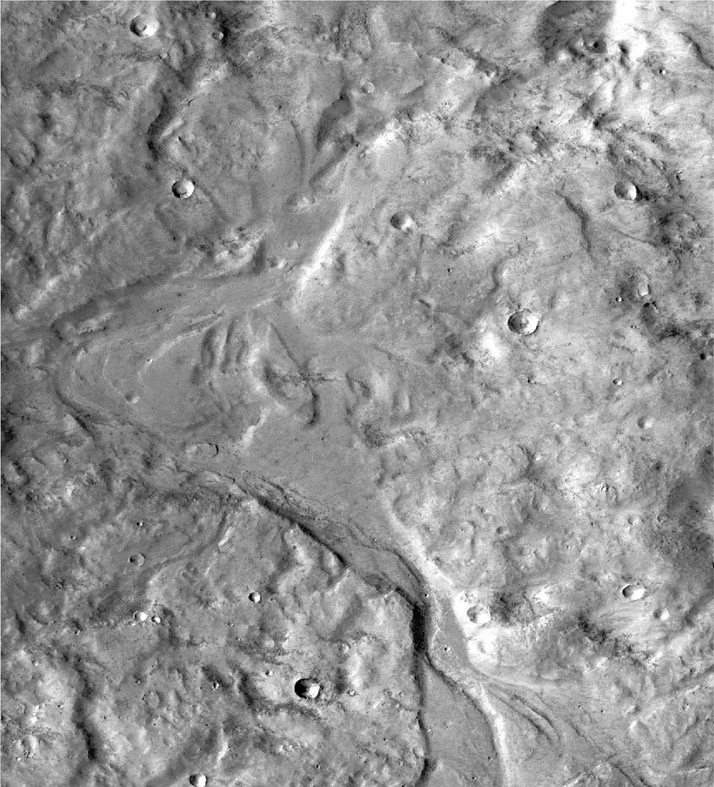 This image taken by NASA's Mars Reconnaissance Orbiter covers an area about 8 miles wide in the northern Arabia Terra region of Mars. Researchers estimate the stream and the lakes it linked held water at some time in the range of 2-3 billion years ago.