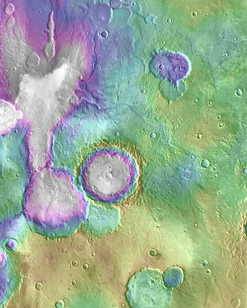 Valleys much younger than well-known ancient valley networks on Mars are evident near the informally named 'Heart Lake' on Mars. This map based on NASA's MGS data presents color-coded topographical information overlaid onto a photo mosaic.