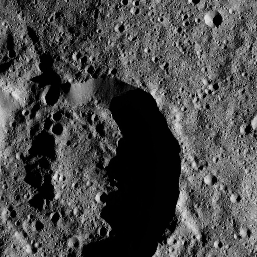 This image from NASA's Dawn spacecraft shows an unnamed impact feature that lies on the northern rim of Chaminuka Crater in Ceres' southern hemisphere.