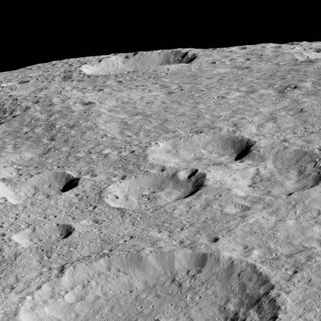 NASA's Dawn spacecraft looked northward toward the limb of Ceres to capture this scene, with Rao Crater (7 miles, 12 kilometers) at bottom.