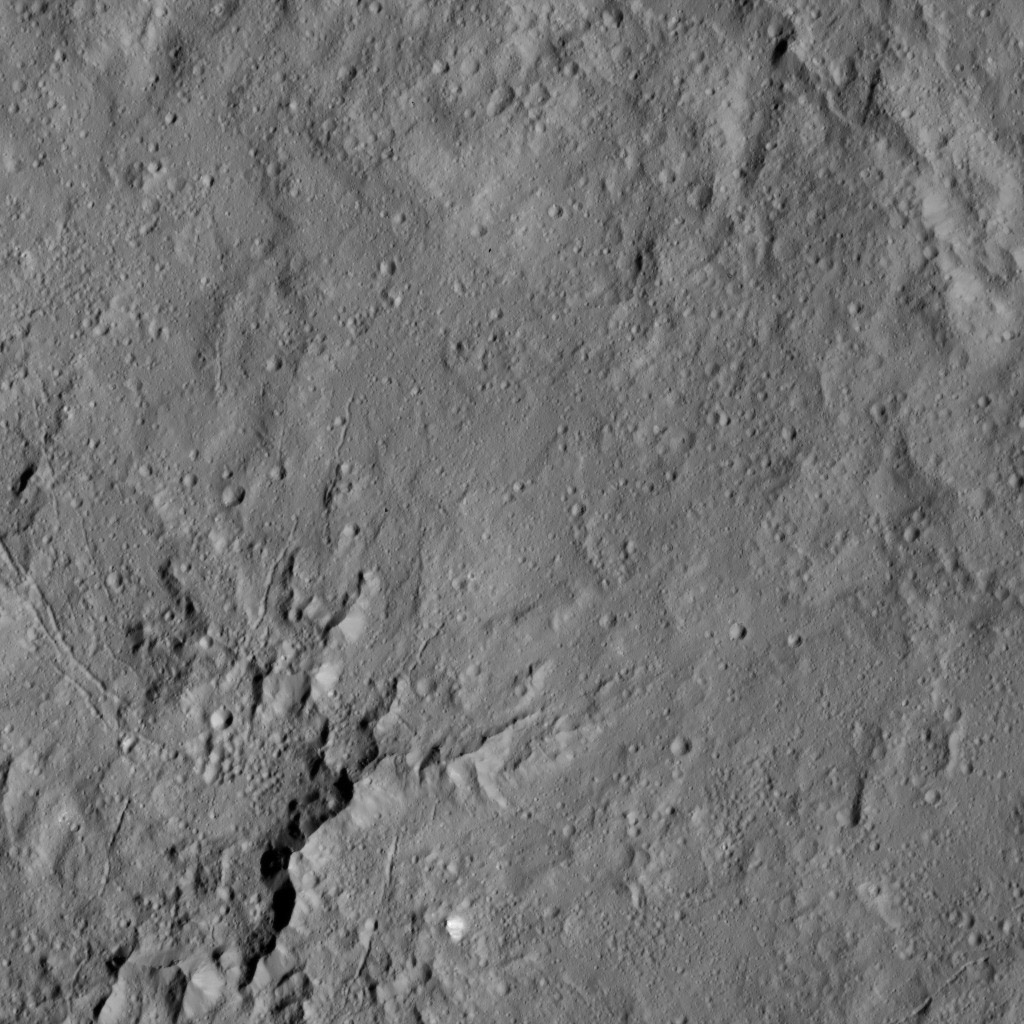 This view from NASA's Dawn spacecraft shows peaks in the center of Dantu Crater (78 miles, 125 kilometers) on Ceres. Dantu is named for a Ghanan god associated with the planting of corn.