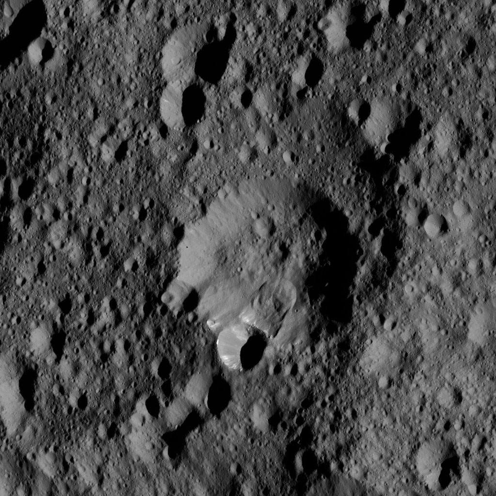 An area along the rim of the crater at the center of this view from NASA's Dawn spacecraft, has collapsed, producing a lobe-shaped feature where the material settled.