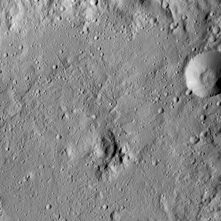 This view from NASA's Dawn spacecraft taken on May 30, 2016, at a distance of about 240 miles (385 kilometers) above the surface, shows the center of Gaue Crater (52 miles or 84 kilometers wide) on Ceres.
