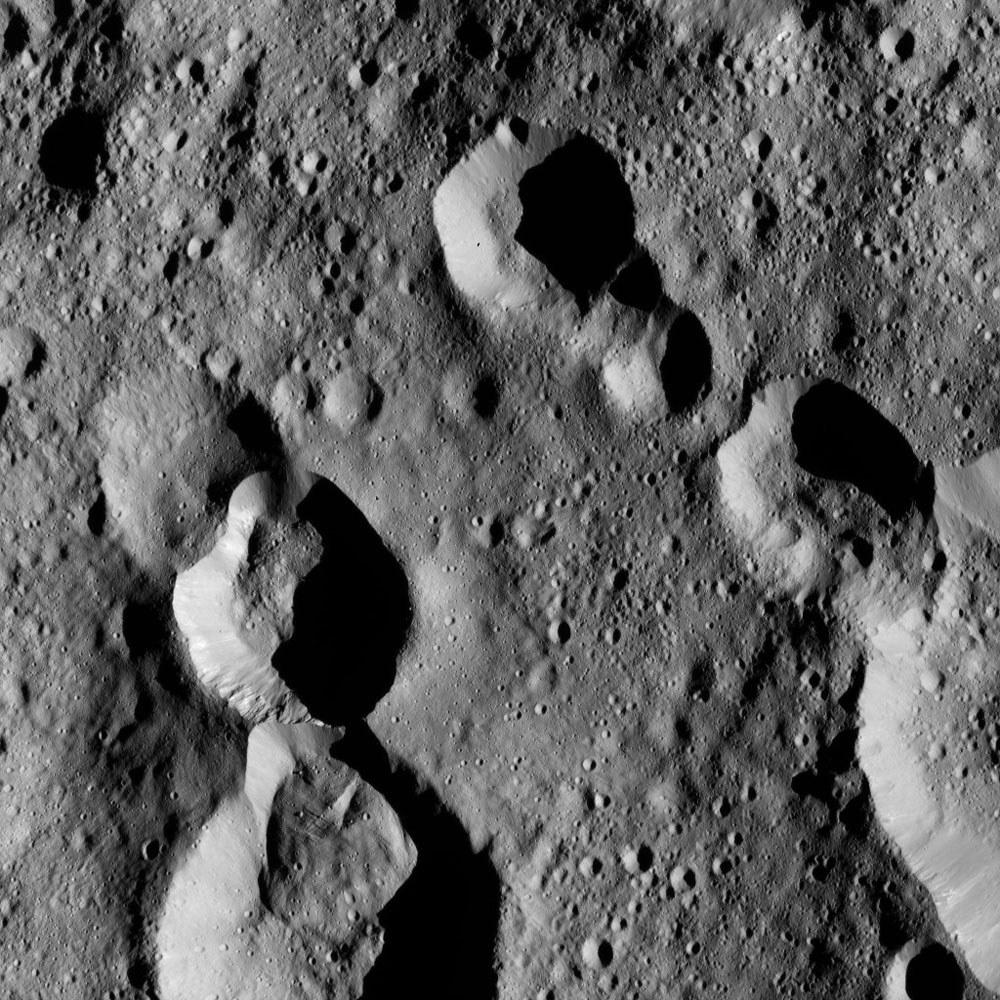 This view from NASA's Dawn spacecraft shows cratered terrain at 59 degrees north latitude, 89 degrees east longitude on Ceres, just east of the large crater named Omonga.